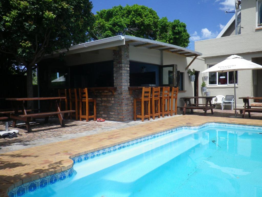 The swimming pool at or near Hermanus Backpackers & Budget Accommodation