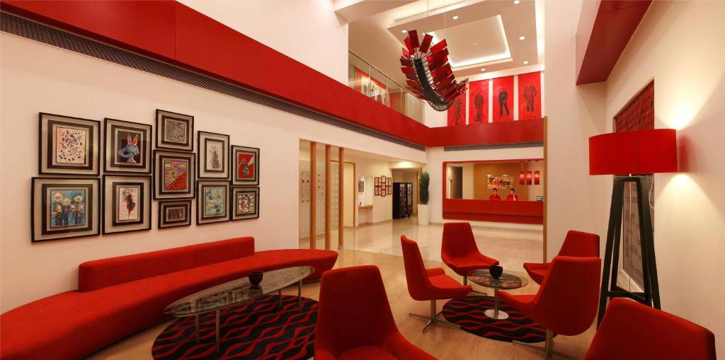 A seating area at Red Fox Hotel, Delhi Airport