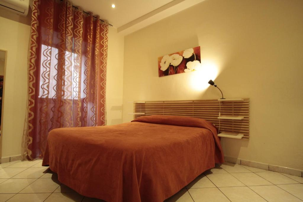 A bed or beds in a room at Vesta-Apartments