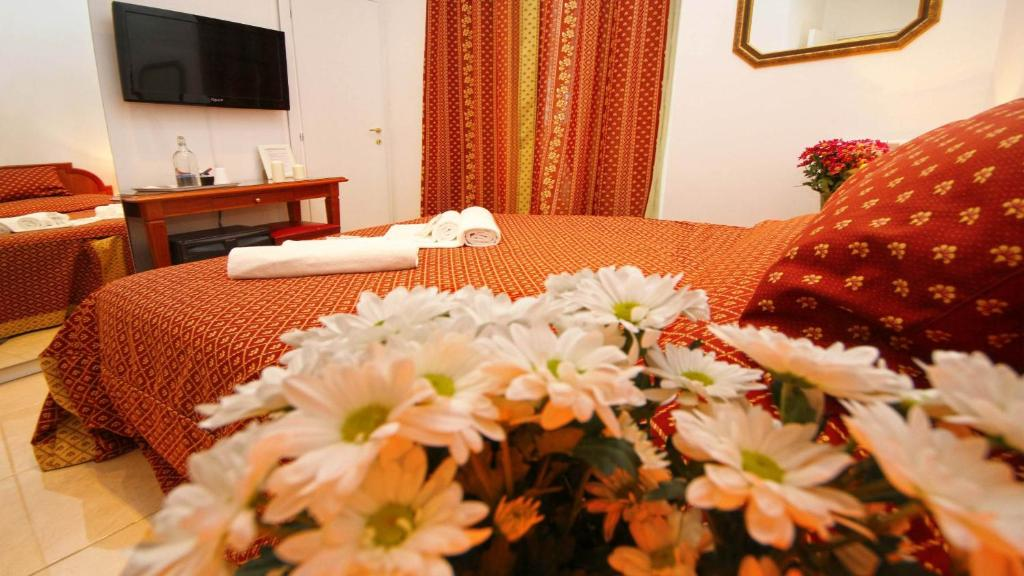 A bed or beds in a room at Key Rome Center