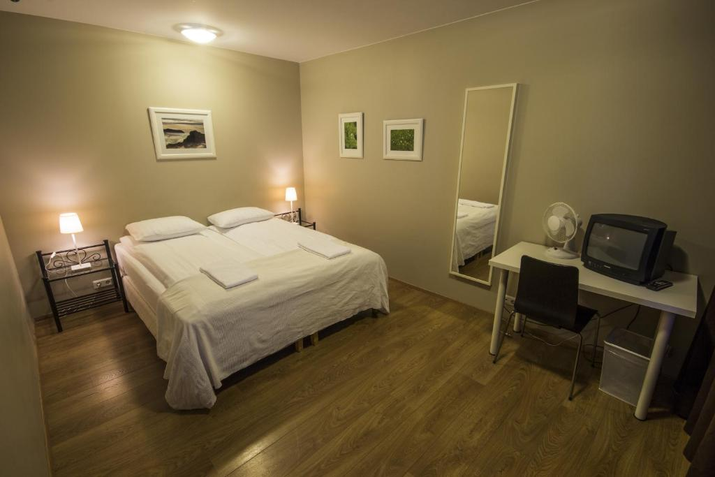 A bed or beds in a room at Lyngás Guesthouse