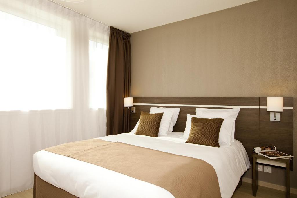Un ou plusieurs lits dans un hébergement de l'établissement Séjours & Affaires Massy Atlantis