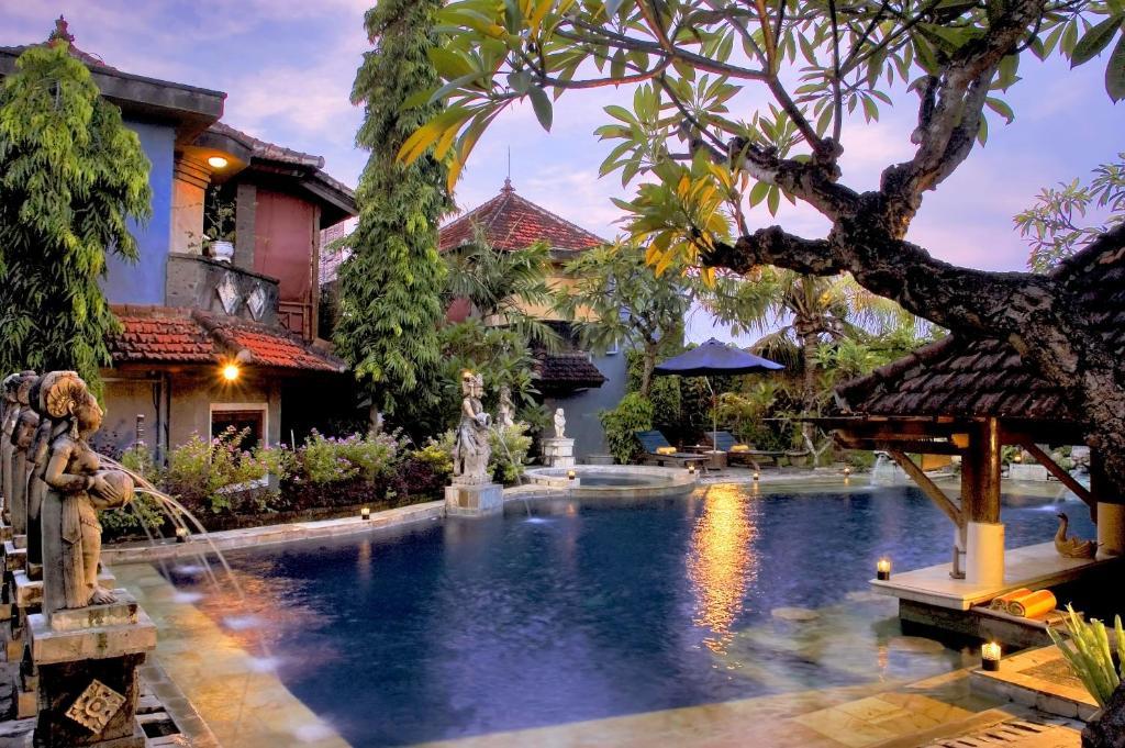 The swimming pool at or near Putu Bali Villa & Spa