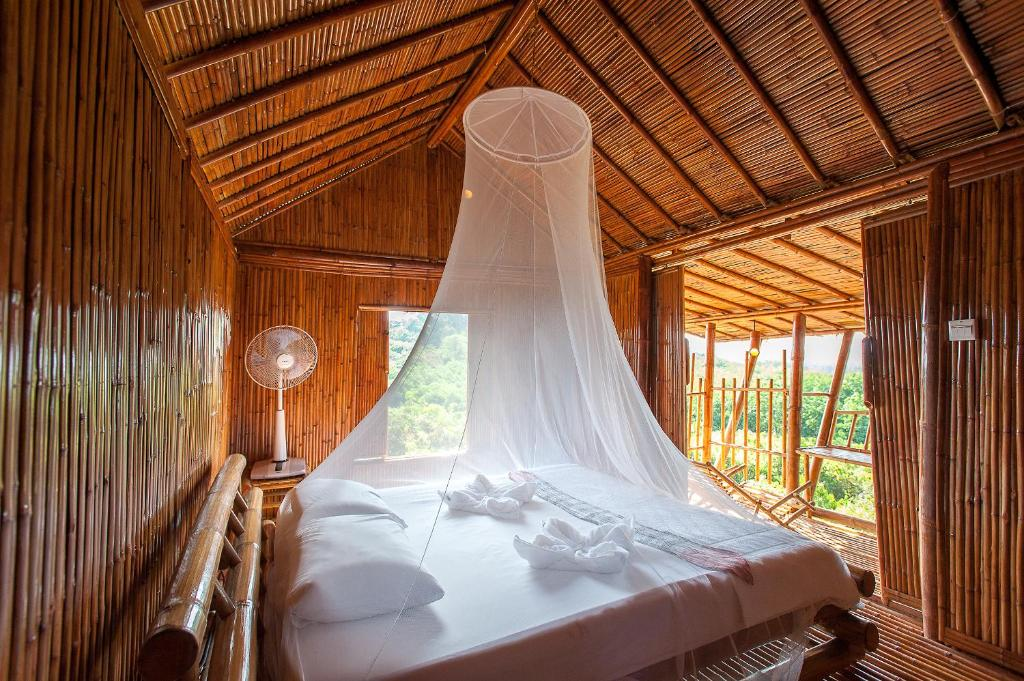 A bed or beds in a room at Phuree Hut
