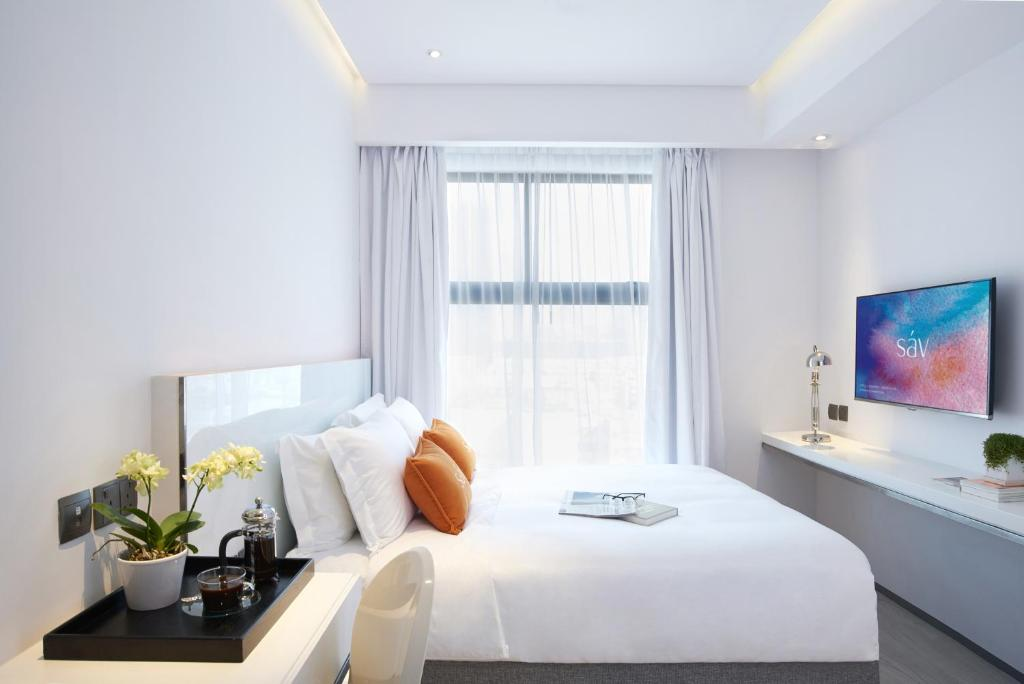 เตียงในห้องที่ Hotel Sav