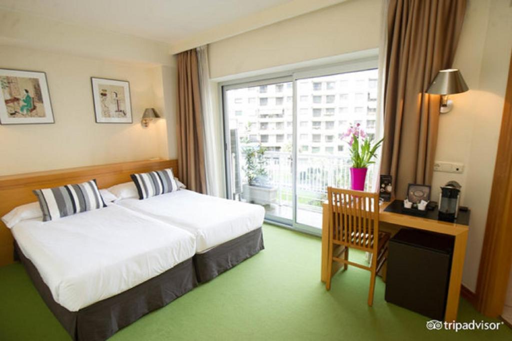 Un ou plusieurs lits dans un hébergement de l'établissement Hotel Zaragoza Plaza