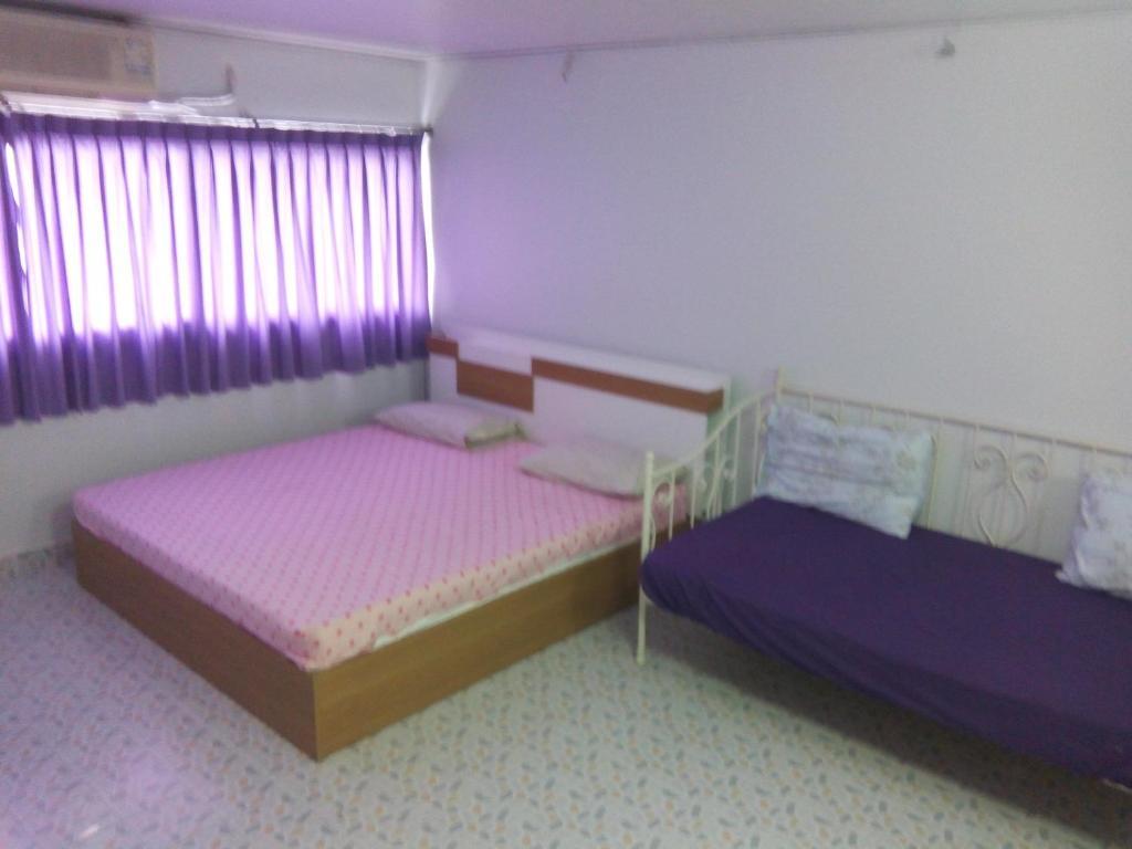찬 킴 돈므앙 게스트하우스 객실 침대