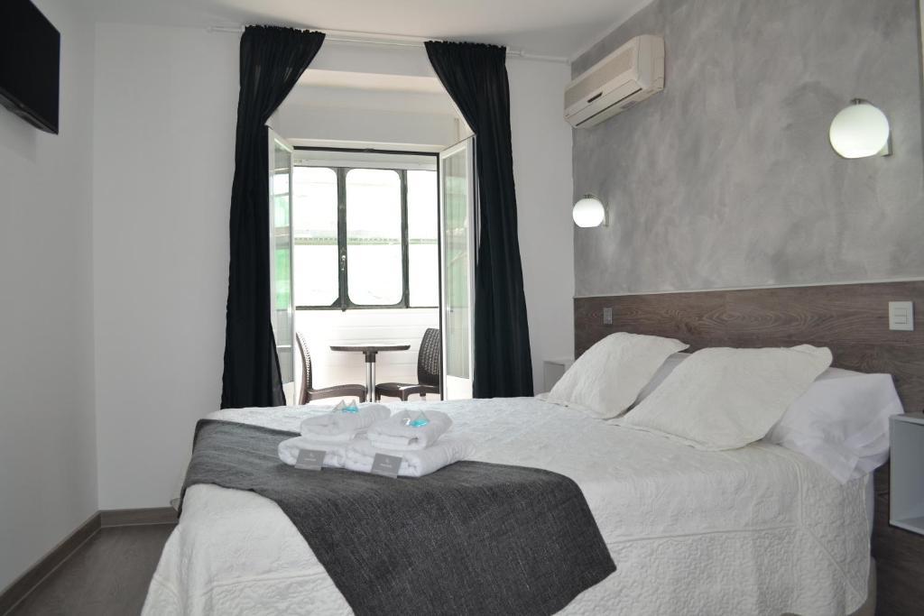 Cama o camas de una habitación en Hostal Meyra