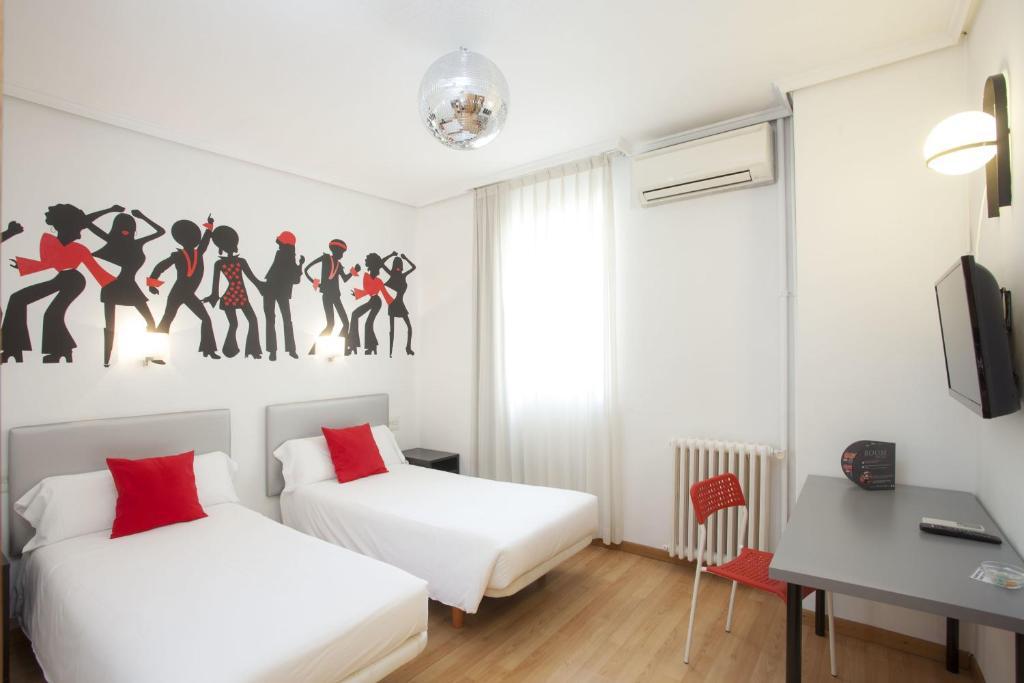 A bed or beds in a room at Casual de la Música Valencia