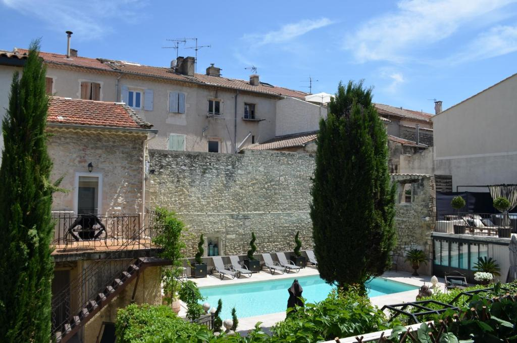 A view of the pool at Hôtel Gounod or nearby