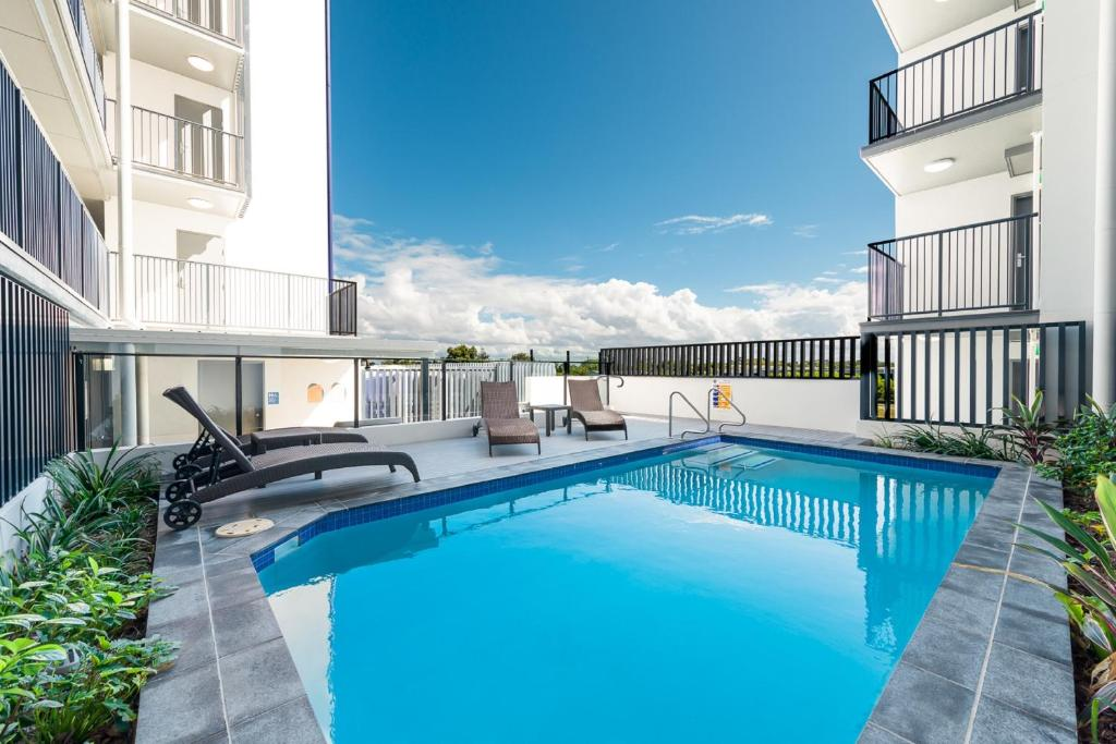 The swimming pool at or near Direct Hotels - Pacific Sands