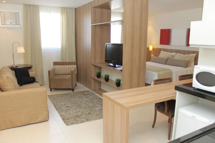 A television and/or entertainment center at Faria Lima Flat Service