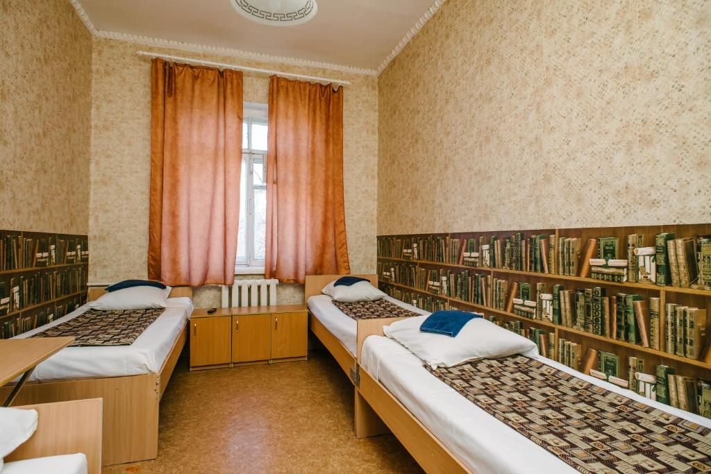 A bed or beds in a room at Zvezda Hostel