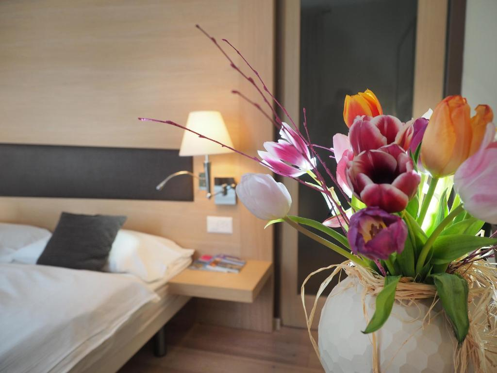 A bed or beds in a room at Charme Hotel Ristorante T3e Terre