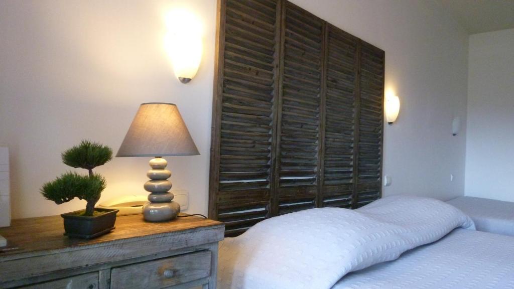Un ou plusieurs lits dans un hébergement de l'établissement Hôtel de l'Océan