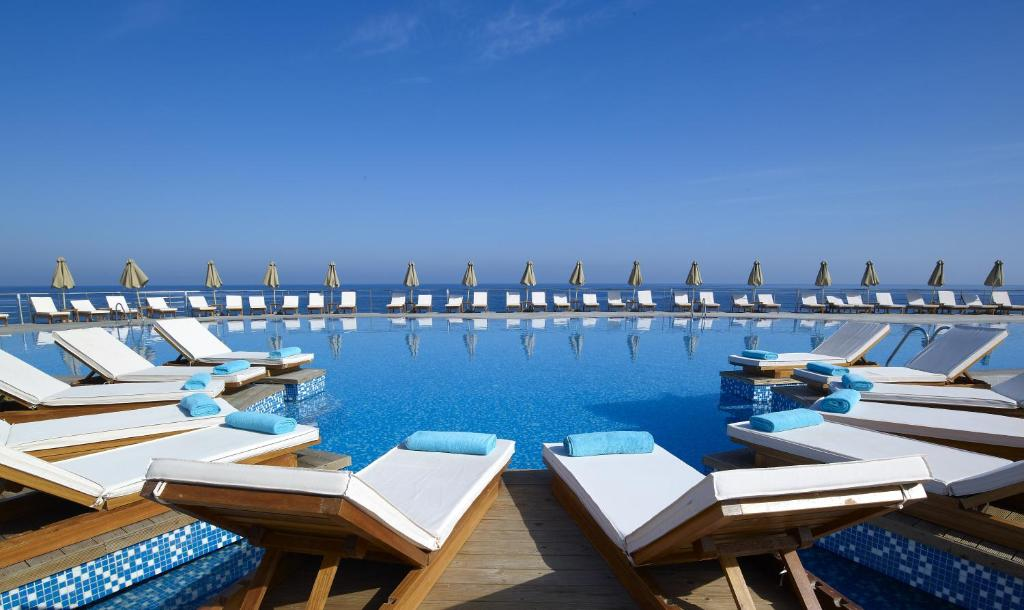 The swimming pool at or near The Royal Blue a Luxury Beach Resort