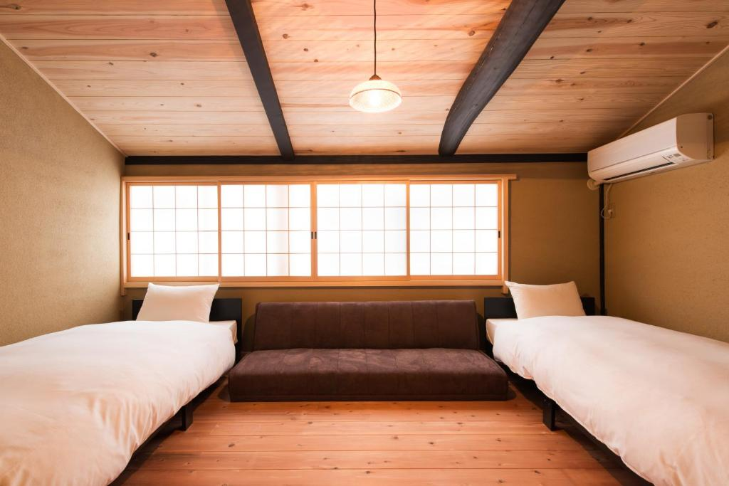 A bed or beds in a room at Hoteian Holiday Rentals