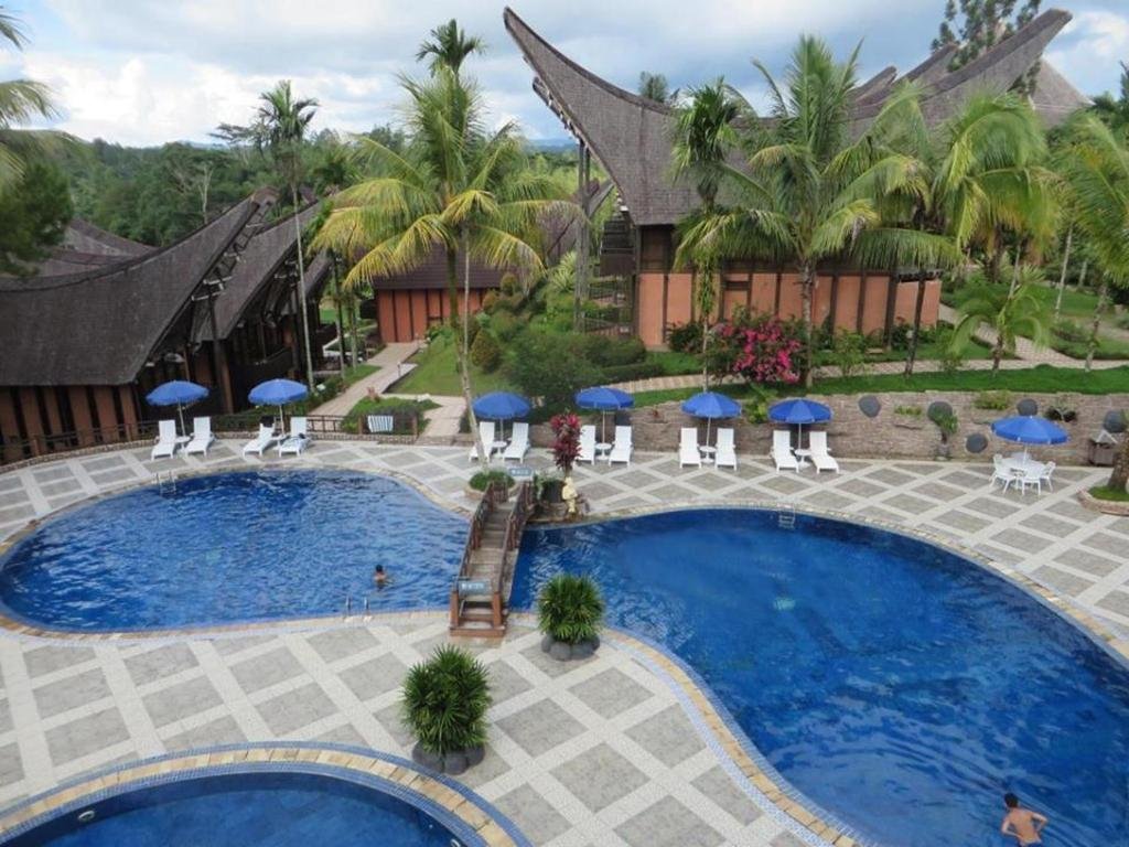 The swimming pool at or close to Toraja Heritage Hotel