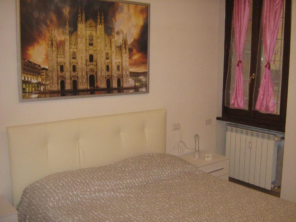 Letto o letti in una camera di Flat in Milan 2