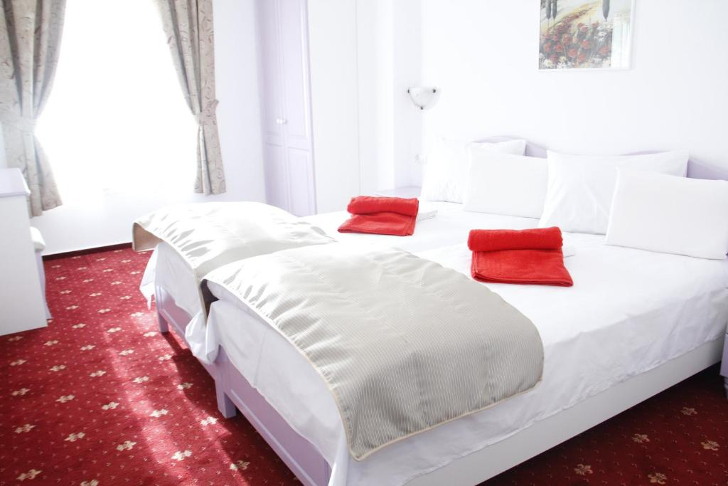 A bed or beds in a room at Hotel Exclusiv