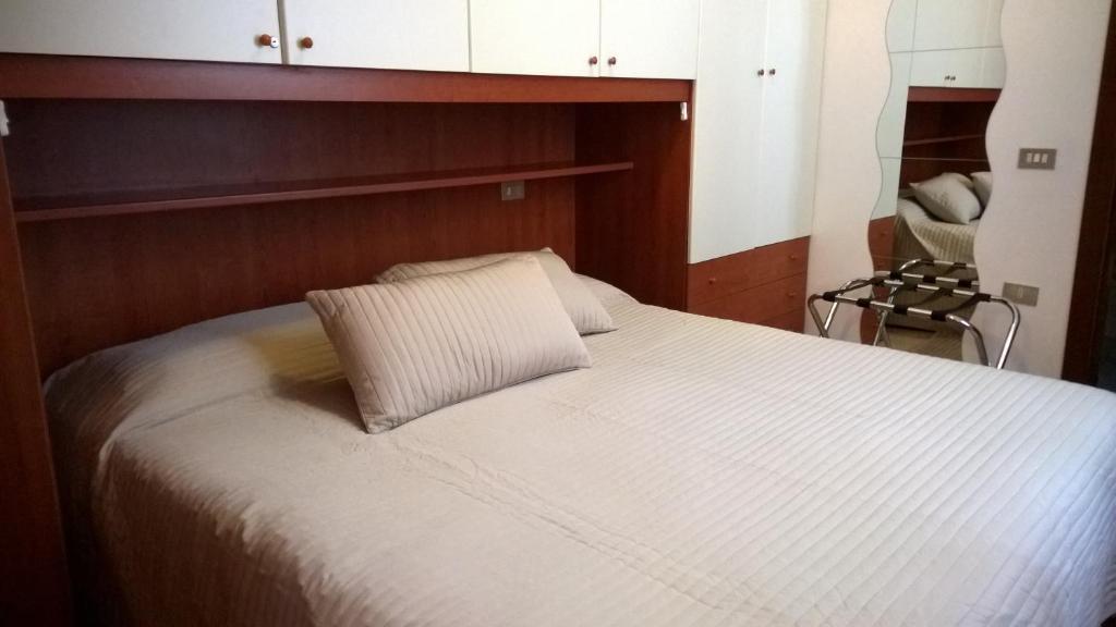 Letto o letti in una camera di Appartamenti i Liutai