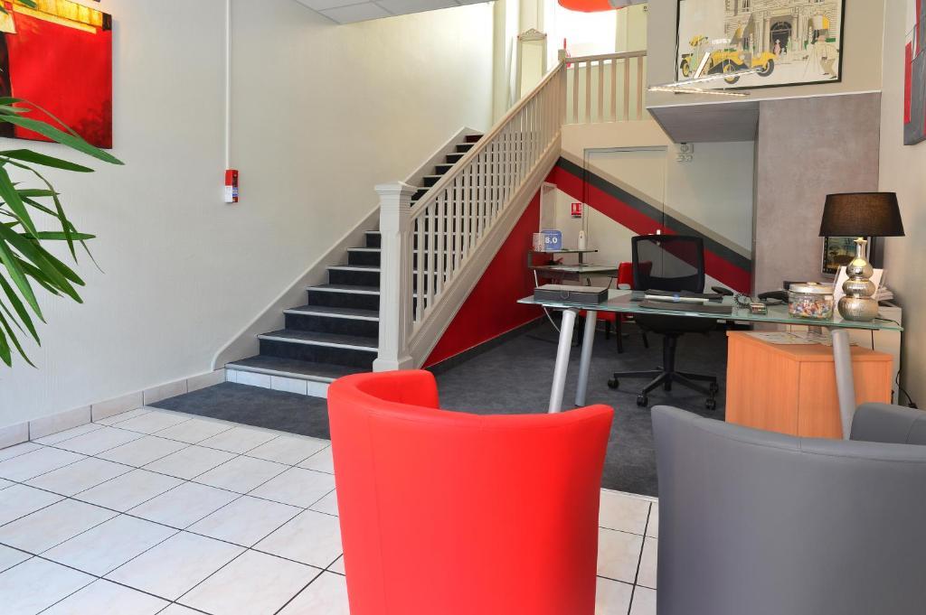 Cuisine ou kitchenette dans l'établissement Hôtel La Croix Blanche