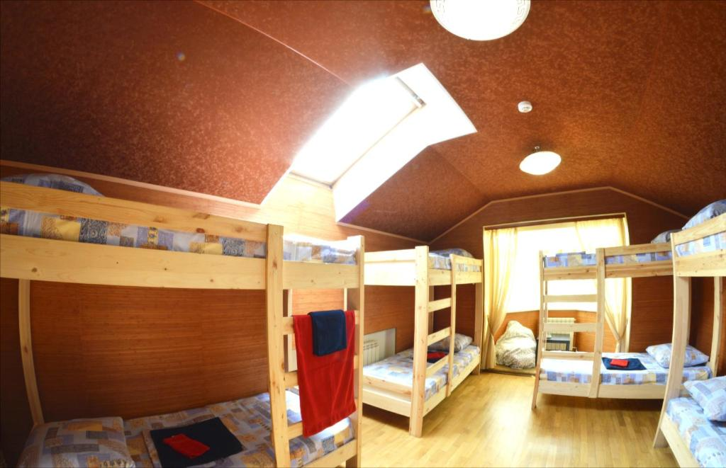 A bunk bed or bunk beds in a room at Hostel Wow