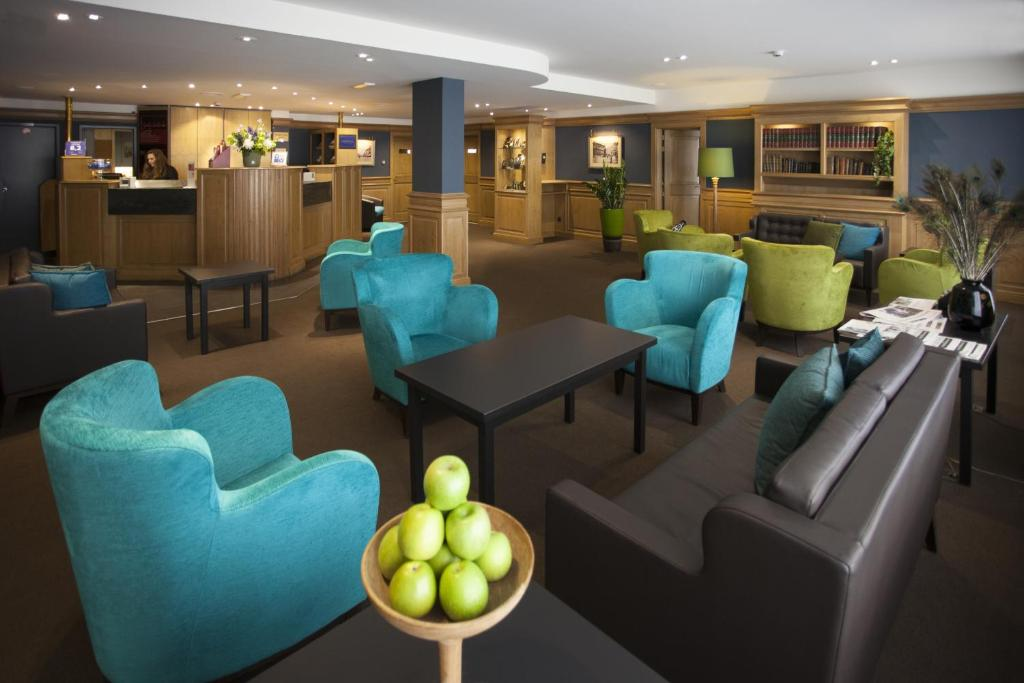 The lounge or bar area at Theater Hotel