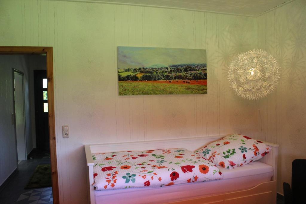 Ein Bett oder Betten in einem Zimmer der Unterkunft Ferienhaus Helferskirchen