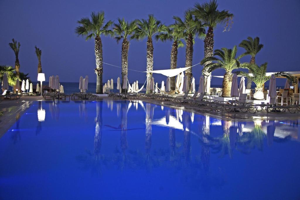 The swimming pool at or near Vrissiana Beach Hotel
