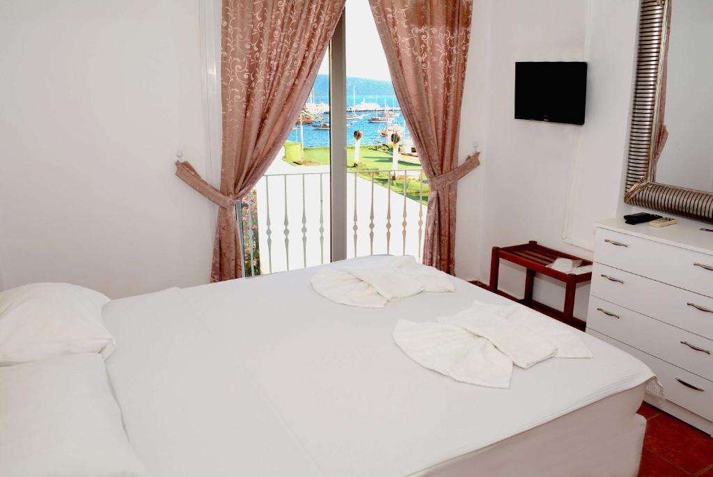 Кровать или кровати в номере Angora Hotel