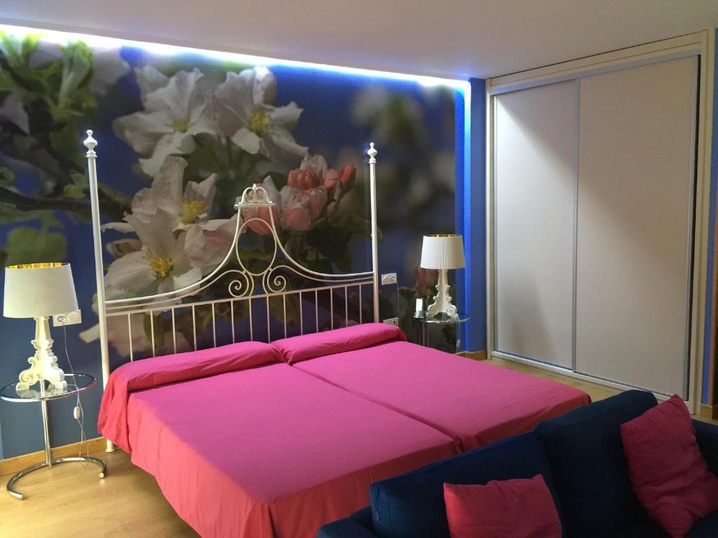 A bed or beds in a room at Optima Capitolio Apartamentos Turísticos