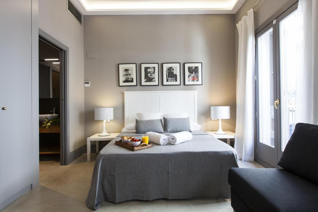 A bed or beds in a room at Kare No By Aspasios