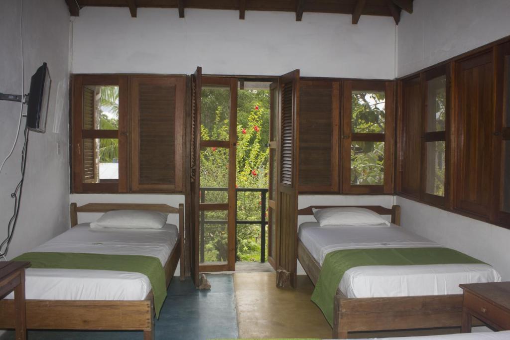 Cama o camas de una habitación en Waira Selva Hotel