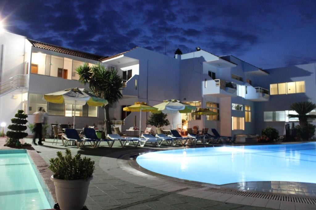 The swimming pool at or near Corellia Asterias Beach Hotel