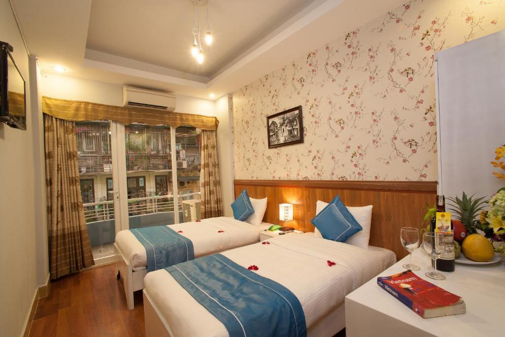 Giường trong phòng chung tại Hanoi Brother Inn & Travel