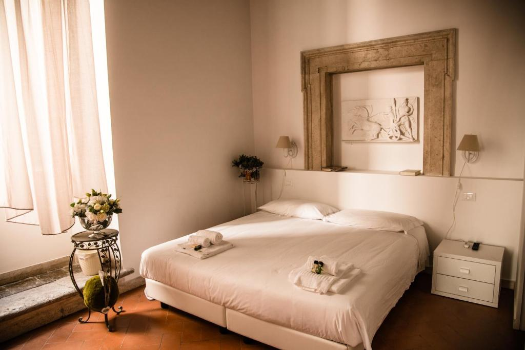 A bed or beds in a room at Guestlovers