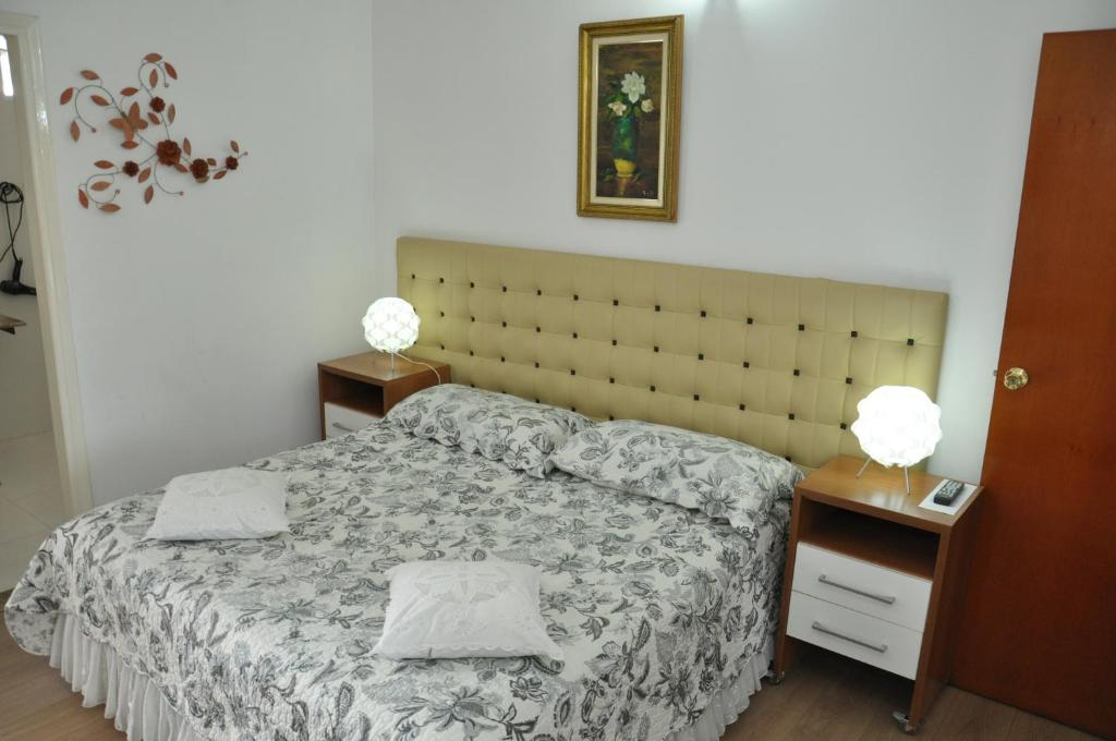 A bed or beds in a room at Magnólia Hotel
