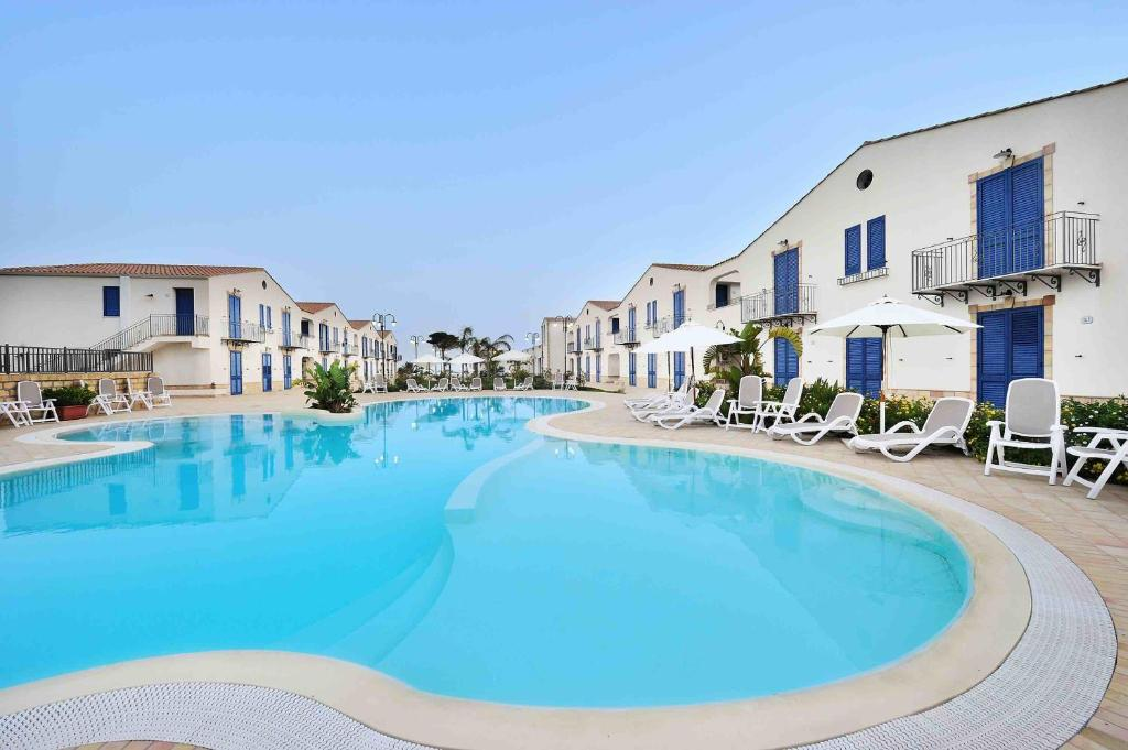 The swimming pool at or near Scala Dei Turchi Resort