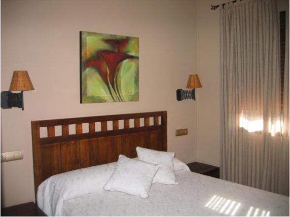 Cama o camas de una habitación en Hotel Rural Robles
