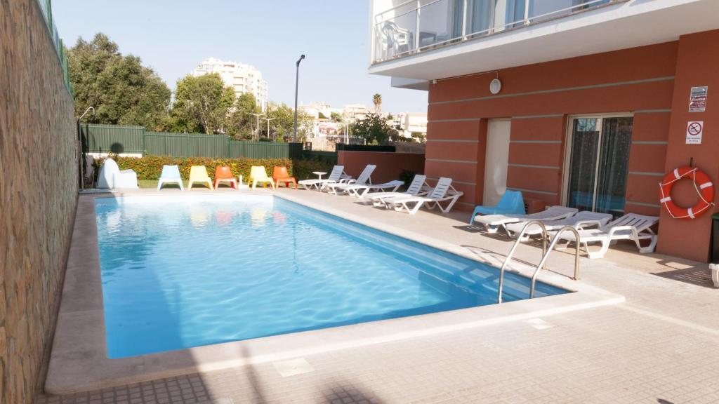 The swimming pool at or near Studio 17 by Atlantichotels - AL