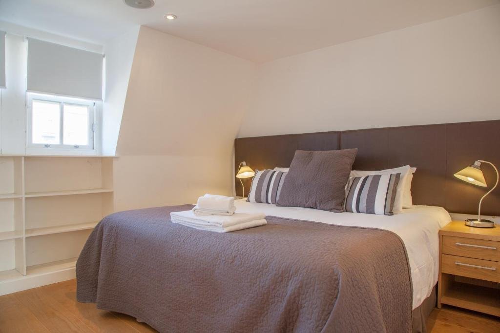 A bed or beds in a room at My-Canning Street Apartments