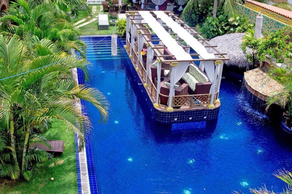 Uma vista da piscina em Pousada Presidente Hotel ou nos arredores