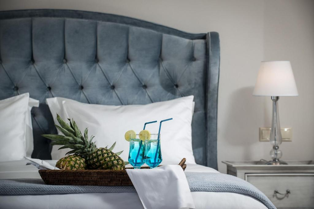 A bed or beds in a room at Creta Blue Luxury Collection (Adults Only)