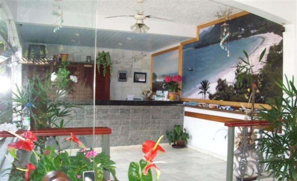 O saguão ou recepção de Hotel Pousada Miramar