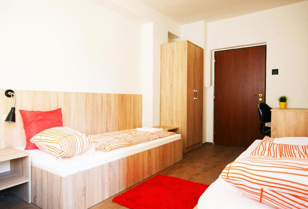 A bed or beds in a room at Hostel Bratislava by Freddie