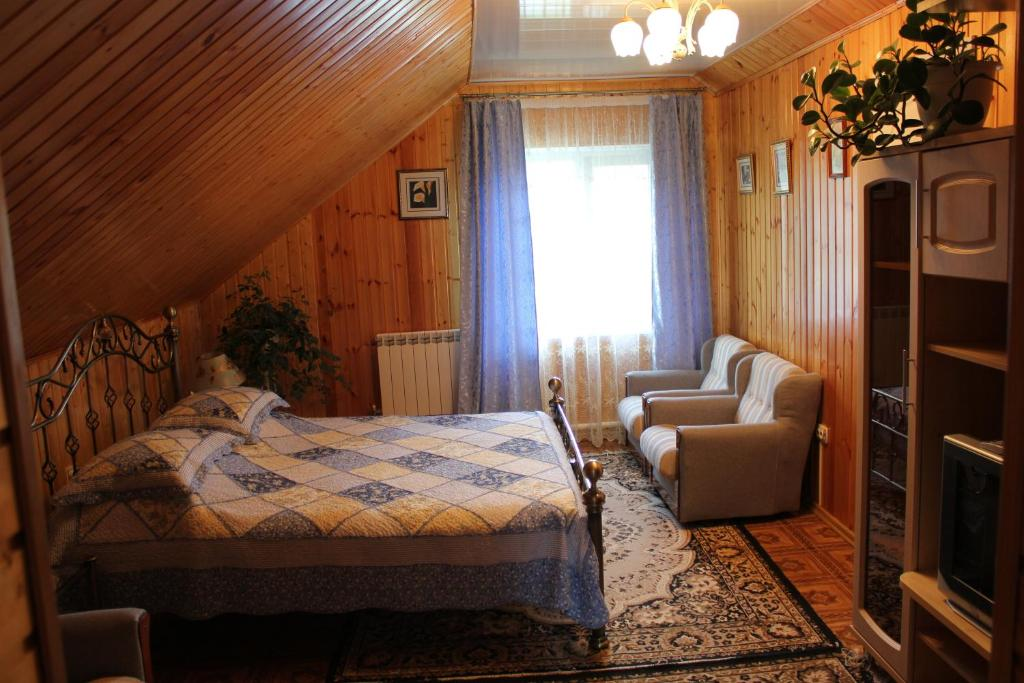 A bed or beds in a room at Guest House at Spass