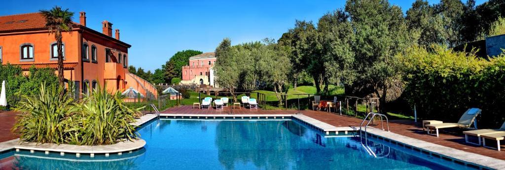 The swimming pool at or near Il Picciolo Etna Golf Resort & Spa
