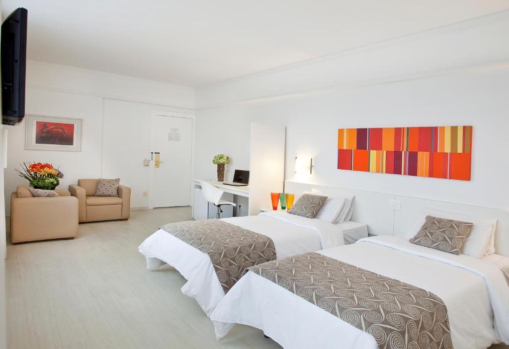 En eller flere senge i et værelse på Boulevard Plaza