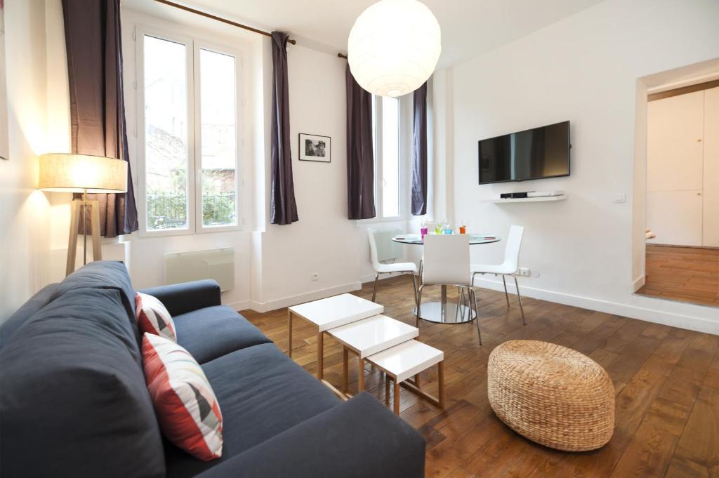Coin salon dans l'établissement Pick a Flat - Residence Mornay